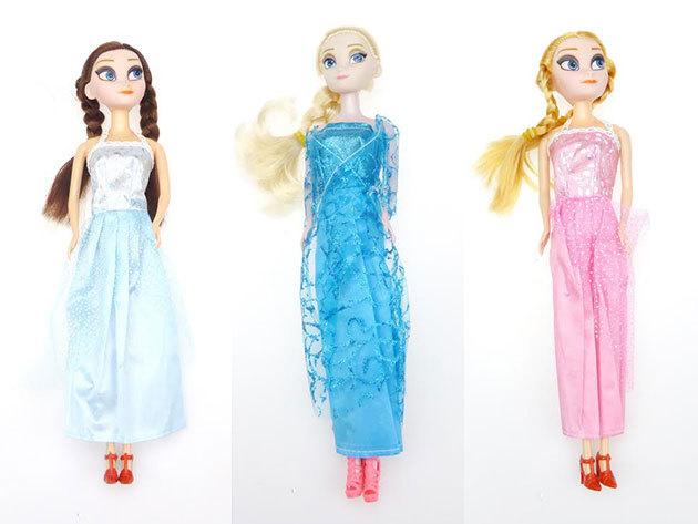 Jégvarázs stílusú babák 4 különböző változatban, szőke vagy barna hajjal, kék vagy lila ruhában, 29 cm-es magassággal