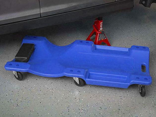Műanyag aláfekvő strapabíró anyagból, kerekekkel, párnás fejtámasszal