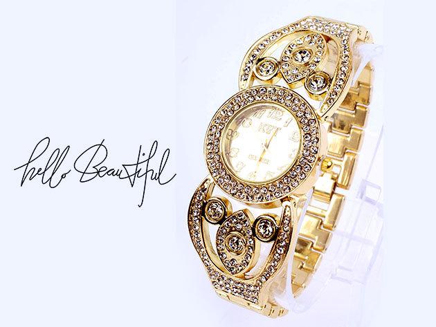 Arany színű karóra kövekkel gazdagon díszítve - az igazi hölgyeknek
